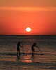 Paddle boarders at Sunset in the Cayman Islands at 7 Mile Beach 12-29-12.